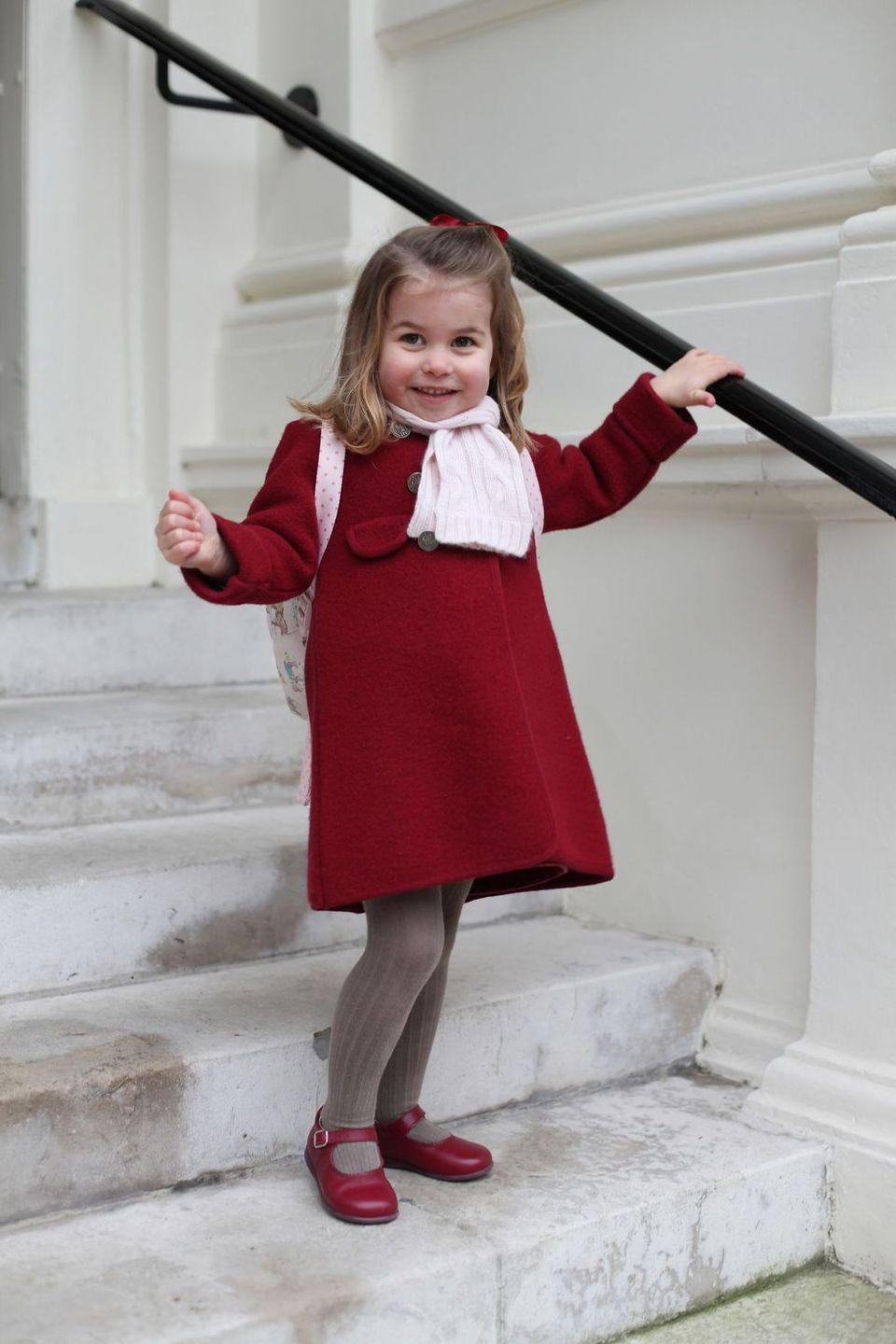 <p>Before Princess Charlotte left for her first day at the Willcocks Nursery School in January of 2018, her mom snapped this picture on the steps at Kensington Palace.</p>