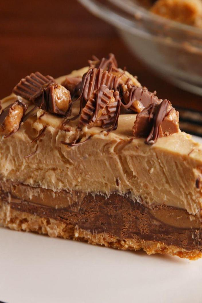 """<p>Peanut butter and chocolate, and unbeatable combination.</p><p>Get the recipe from <a href=""""https://www.delish.com/cooking/recipe-ideas/recipes/a52014/reeses-stuffed-pie-recipe/"""" rel=""""nofollow noopener"""" target=""""_blank"""" data-ylk=""""slk:Delish"""" class=""""link rapid-noclick-resp"""">Delish</a>.</p>"""