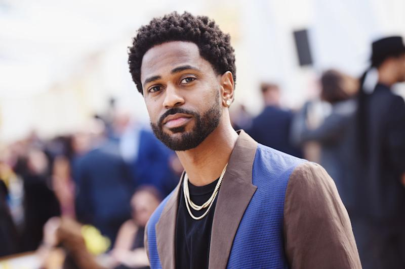Big Sean looks amazing in this brown and blue color suit with inner black round-neck shirt and pant to match
