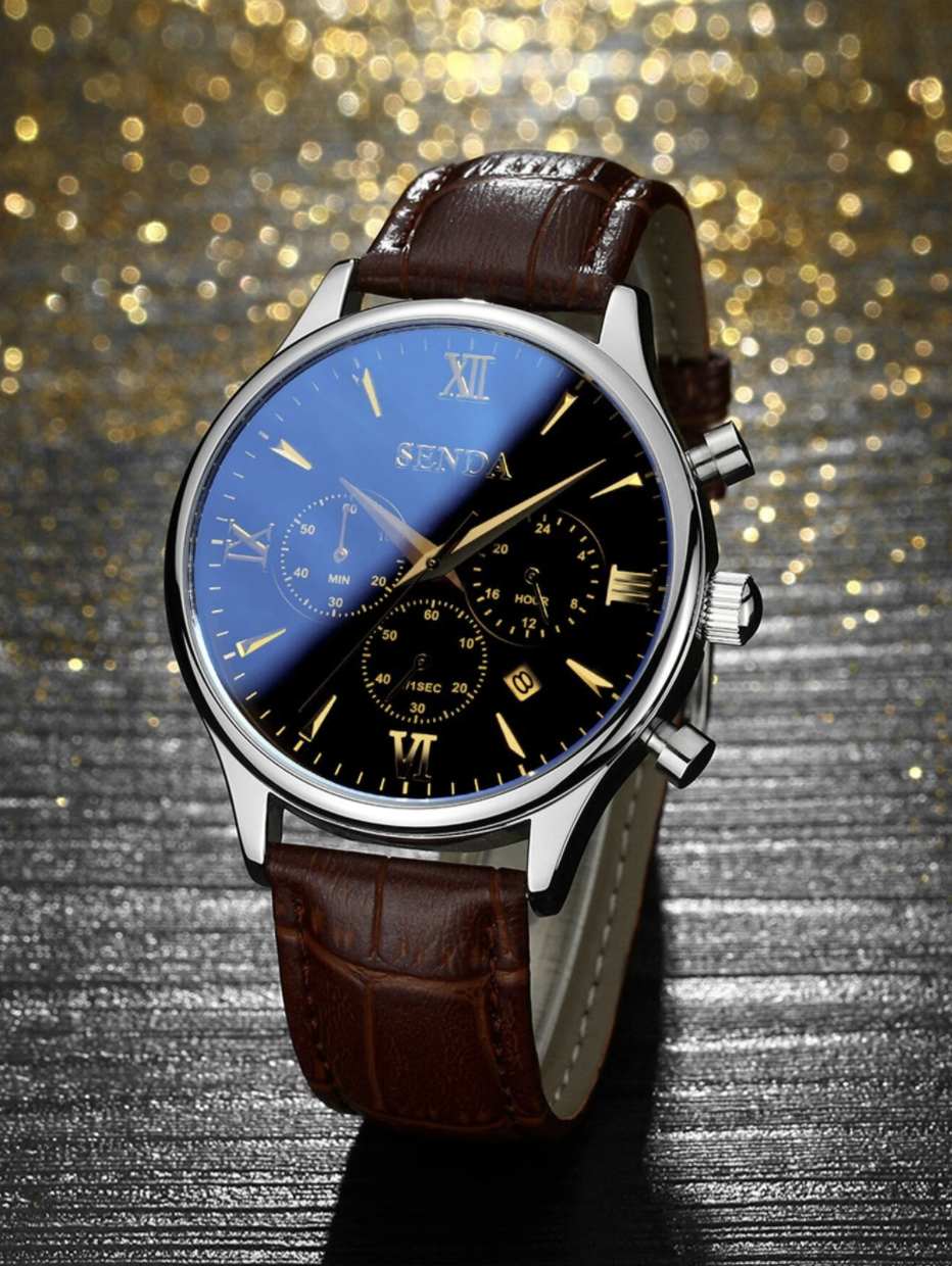 brown leather watch with gold, silver, and black watch face on glitter background