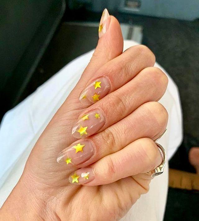 "<p>Clear nails plus gold stars equals the floating illusion mani of our dreams. </p><p><a href=""https://www.instagram.com/p/BxHeKEanzBm/"" rel=""nofollow noopener"" target=""_blank"" data-ylk=""slk:See the original post on Instagram"" class=""link rapid-noclick-resp"">See the original post on Instagram</a></p>"