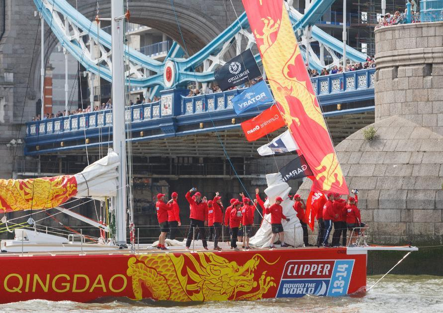 The Qingdao yacht goes through tower bridge during the start of the Clipper Round the World Race at St Katharine Docks, London.