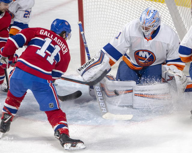Montreal Canadiens right wing Brendan Gallagher (11) is stopped by New York Islanders goaltender Thomas Greiss (1) during second period NHL hockey action Tuesday, Dec. 3, 2019 in Montreal. (Ryan Remiorz/The Canadian Press via AP)