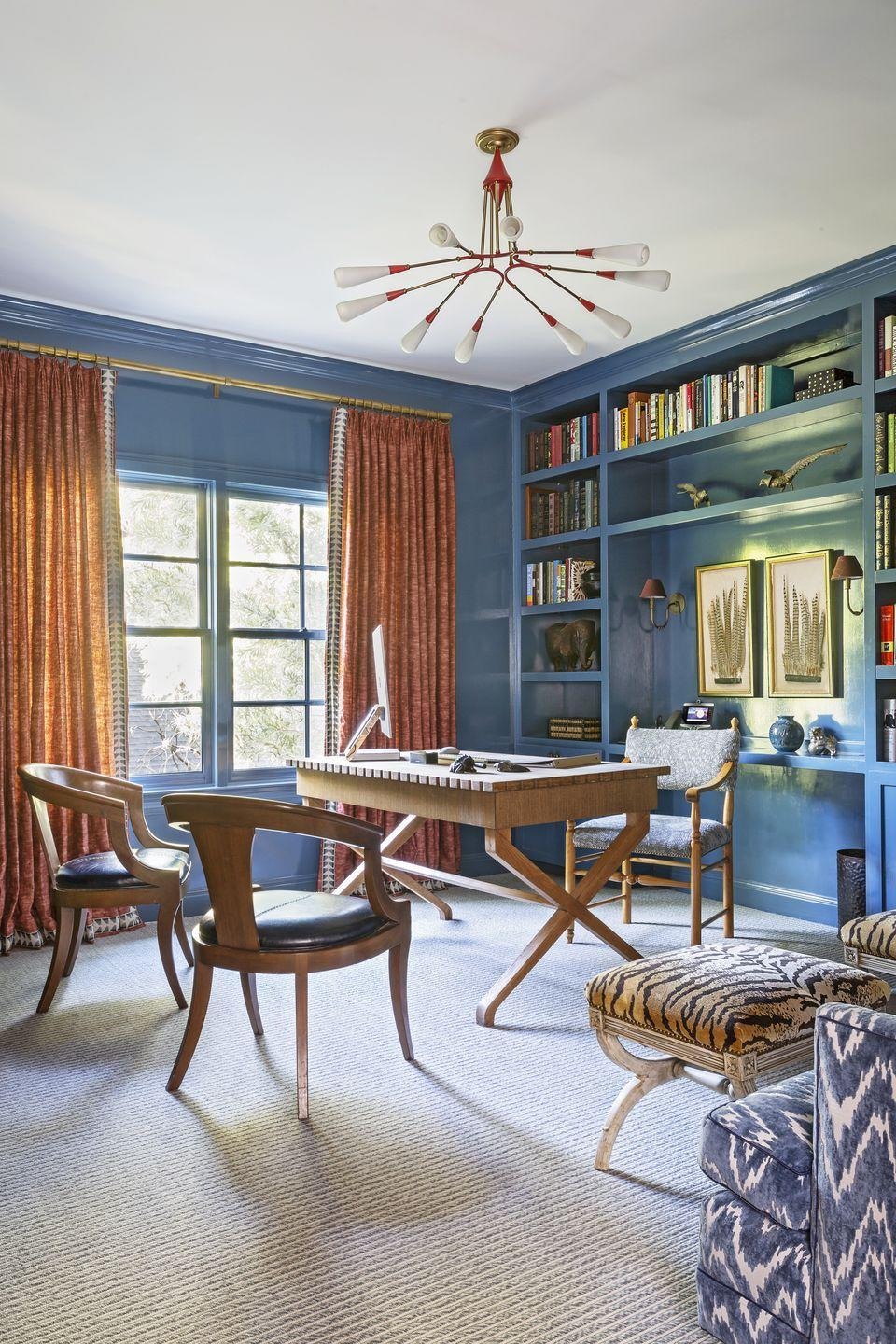 "<p>It's no secret we love lacquer, and <a href=""https://www.veranda.com/decorating-ideas/house-tours/a34883406/angie-hranowsky-austin-house-tour/"" rel=""nofollow noopener"" target=""_blank"" data-ylk=""slk:this artistic Austin home office designed by Angie Hranowsky"" class=""link rapid-noclick-resp"">this artistic Austin home office designed by Angie Hranowsky</a> is the perfect place to bring vibrance to a workspace. Accented with light wood, a funky blend of patterns, modern lighting, and built-ins full of objets d' art, this space is ideal for any creative looking to zhush up their four walls.</p>"