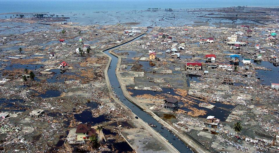 An aerial shot shows flattened houses near the sea coast of Banda Aceh, 05 January 2005. Source: AFP via Getty Images