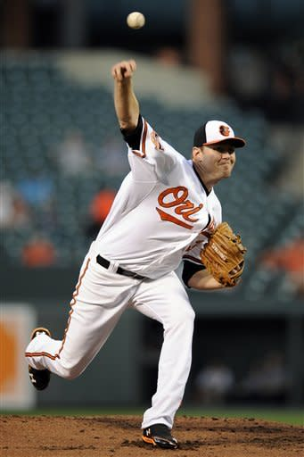 Baltimore Orioles starting pitcher Chris Tillman delivers against the Chicago White Sox during the second inning of a baseball game, Tuesday, Aug. 28, 2012, in Baltimore. (AP Photo/Nick Wass)