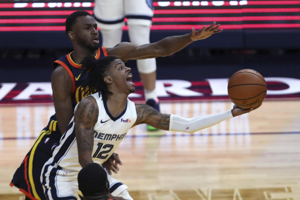 Memphis Grizzlies' Ja Morant (12) shoots against Golden State Warriors' Andrew Wiggins during the second half of an NBA basketball Western Conference play-in game in San Francisco, Friday, May 21, 2021. (AP Photo/Jed Jacobsohn)
