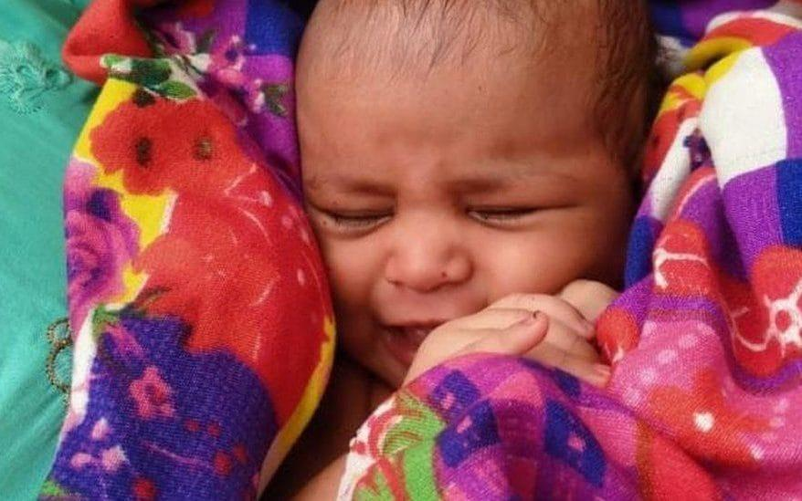 The baby girl wrapped in a blanket - ANIL KUMAR / BBC