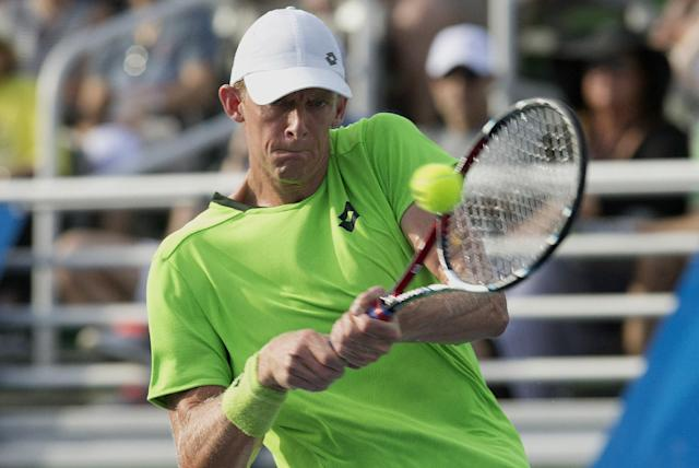Kevin Anderson returns the ball hit by Marin Cilic during the Delray Beach Open tennis tournament, Sunday, Feb. 23, 2014, in Delray Beach, Fla. Cilic won 7-6 (6), 6-7 (7), 6-4. (AP Photo/J Pat Carter)