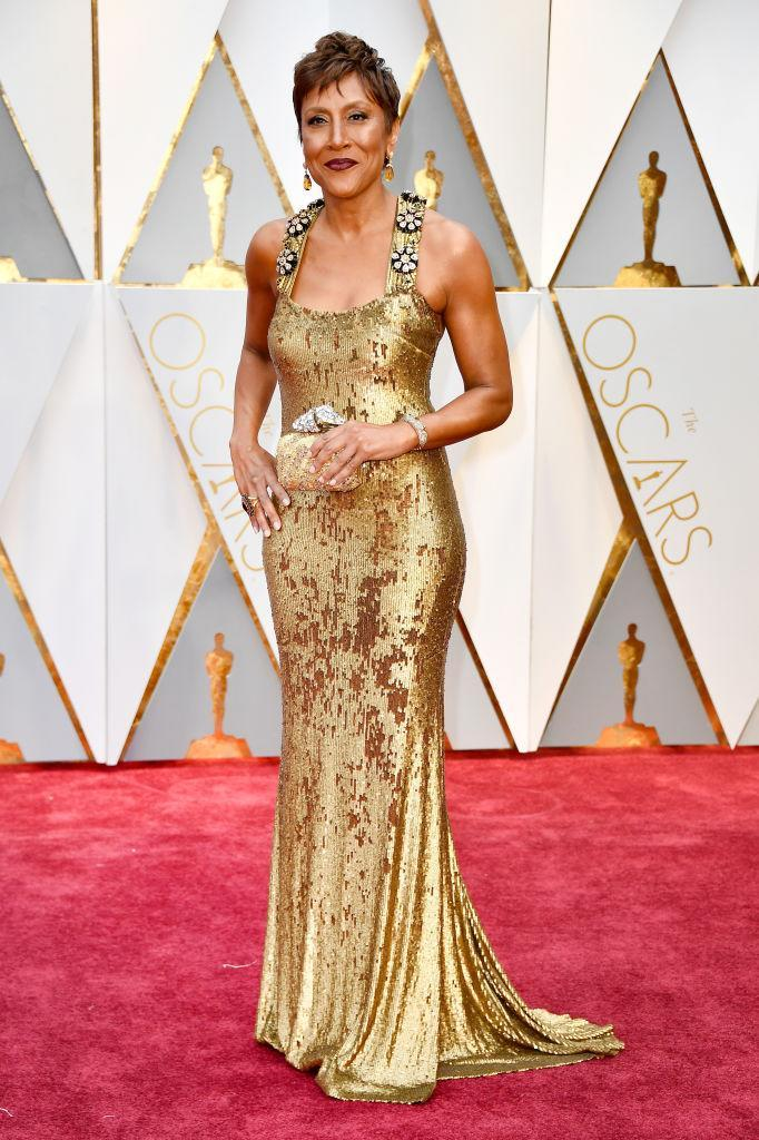 <p>Robin Roberts was working the red carpet as an ABC correspondent, yet her gold Badgley Mischka gown was still one of the best of the night. <em>(Photo: Getty Images)</em> </p>