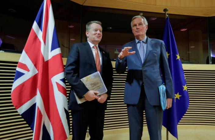 FILE PHOTO: The European Union's chief Brexit negotiator Michel Barnier and British negotiator David Frost at the start of post -Brexit trade deal talks