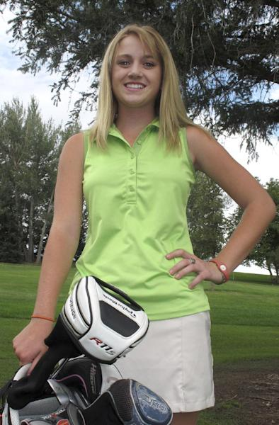 FILE -- A Sept. 6, 2012, file photo shows Sierra Harr, who helped the Castleford High School boy's golf team win Idaho's 2A championship in May, at the Clear Lakes Country Club near Buhl, Idaho. The board that oversees Idaho high school sports won't bar Harr from playing with the boys team if not enough girls turn out and form their own team. (AP Photo/John Miller,file)