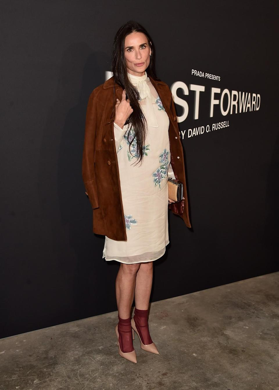 <p>Demi's mish-mash ensemble consisting of a nude high-necked dress and brown suede coat totally worked. The sheer socks were a nice touch too. <i>[Photo: Getty]</i> </p>