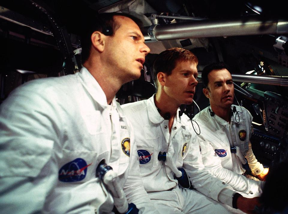 Fred Haise, Jack Swigert, and Jim Lovell wearing their NASA uniforms in the space shuttle