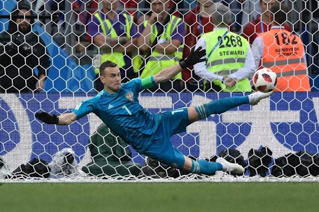 Russia goalkeeper Igor Akinfeev saves from Spain's Iago Aspas in the hosts' penalty shootout win over Spain at the World Cup (AFP Photo/Juan Mabromata)