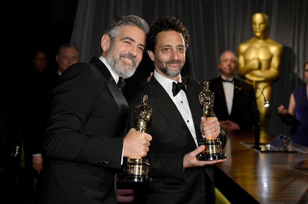 Producers George Clooney and Grant Heslov, winners of the Best Picture award for 'Argo,' attend the Oscars Governors Ball at Hollywood & Highland Center on February 24, 2013 in Hollywood, California.