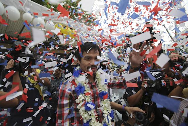 It would be cause for celebration among many boxing fans if Manny Pacquiao (center) and Floyd Mayweather finally meet in the ring. (AP Photo/Aaron Favila)