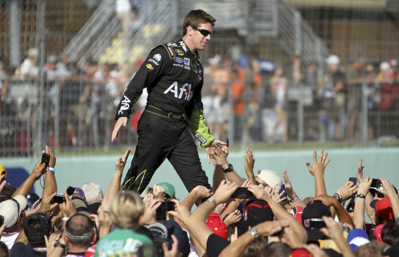 Carl Edwards is introduced before the NASCAR Sprint Cup Series auto race at Homestead-Miami Speedway in Homestead, Fla., Sunday, Nov. 20, 2011. (AP Photo/J Pat Carter)