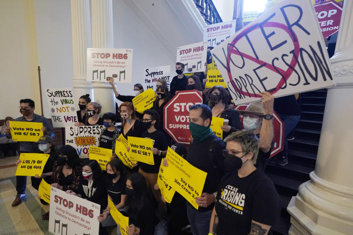 FILE - In this May 6, 2021, file photo, a group opposing new voter legislation gather outside the House Chamber at the Texas Capitol in Austin, Texas. In 2020, election officials tried to make voting easier and safer amid a global pandemic. Next time, they might get fined or face criminal charges. (AP Photo/Eric Gay, File)