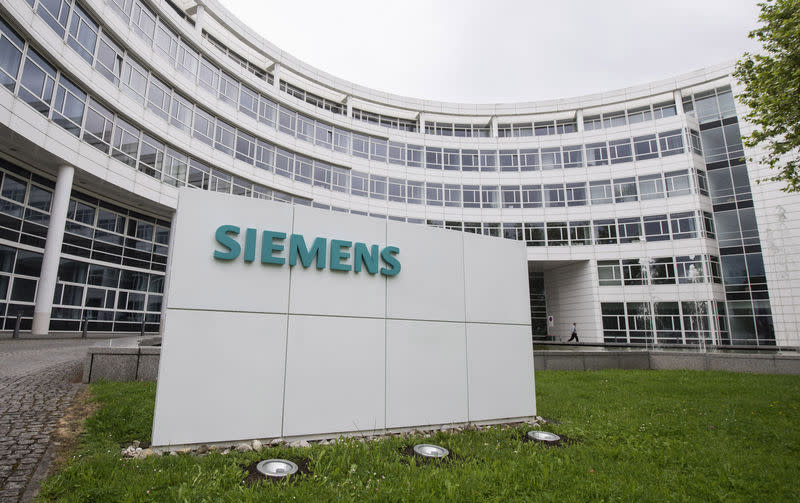A Siemens logo is pictured on an office building of Siemens AG in Munich