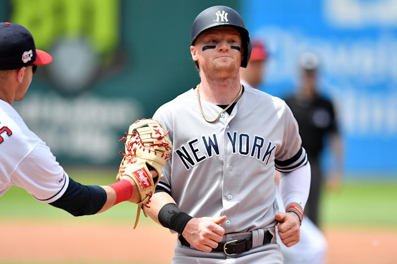 CLEVELAND, OHIO - JUNE 09: First baseman Jake Bauers #10 of the Cleveland Indians catches Clint Frazier #77 of the New York Yankees in a run down during the third inning at Progressive Field on June 09, 2019 in Cleveland, Ohio. (Photo by Jason Miller/Getty Images)