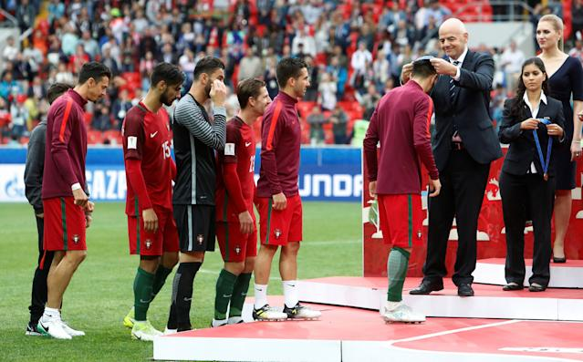 Soccer Football - Portugal v Mexico - FIFA Confederations Cup Russia 2017 - Third Placed Play Off - Spartak Stadium, Moscow, Russia - July 2, 2017 FIFA President Gianni Infantino presents medals to the Portugal players after the game REUTERS/Sergei Karpukhin