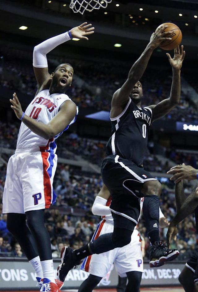 Brooklyn Nets center Andray Blatche (0) goes to the basket against Detroit Pistons center Greg Monroe (10) during the first half of an NBA basketball game on Friday, Dec. 13, 2013, in Auburn Hills, Mich. (AP Photo/Duane Burleson)