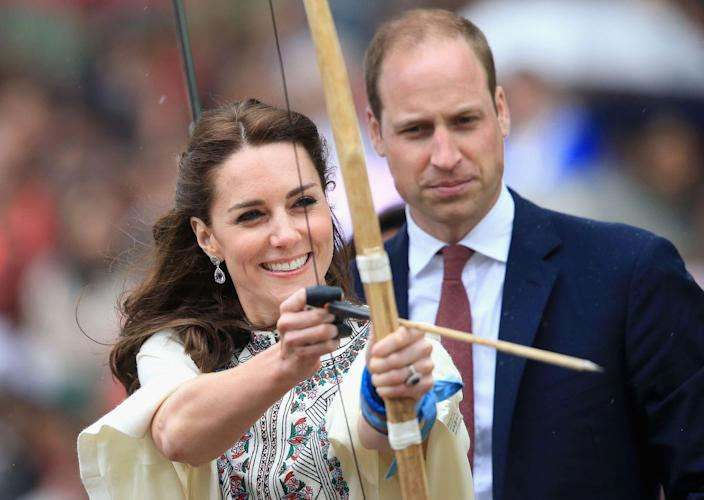 """<p>Is it Kate or Cupid? While <a href=""""https://www.townandcountrymag.com/style/fashion-trends/g2187/kate-middleton-india-bhutan-royal-visit/"""" rel=""""nofollow noopener"""" target=""""_blank"""" data-ylk=""""slk:visiting Bhutan"""" class=""""link rapid-noclick-resp"""">visiting Bhutan</a>, the Duchess fired an arrow at an archery demonstration. Prince William, gazing on, looked a tad concerned. </p>"""
