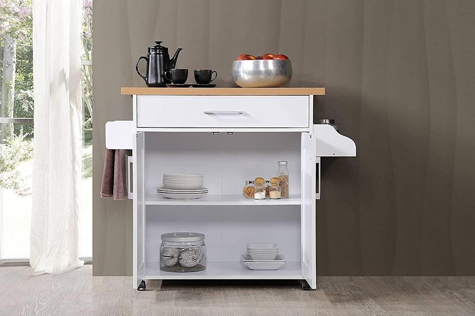 """<p>If you live in an apartment with minimal kitchen storage or want to create a cute coffee bar, the <span>Hodedah Kitchen Island</span> ($92-$95) will brighten up your space. It has a spice rack, a towel rack, a drawer, and cabinetry. It has wheels so you can move it around, perfect for entertaining. It comes in both """"like new"""" and """"very good"""" conditions. </p>"""