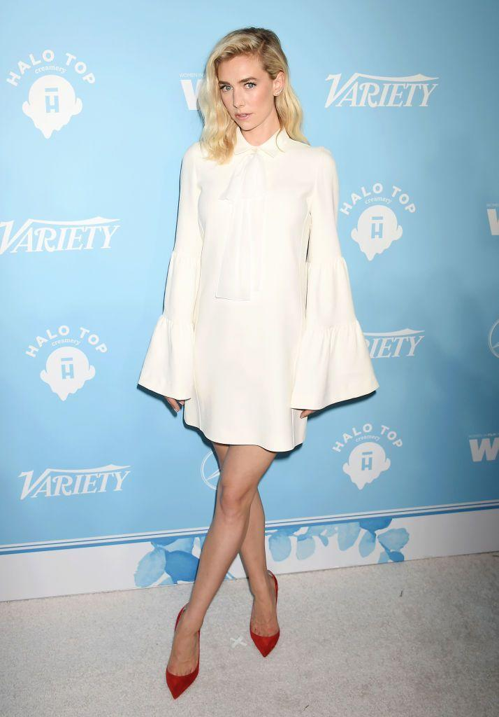 <p>Kirby donned a cream colored mini dress with exaggerated sleeves at yet another Emmys pre-party. For a final touch of color, she opted for red pointed pumps.</p>
