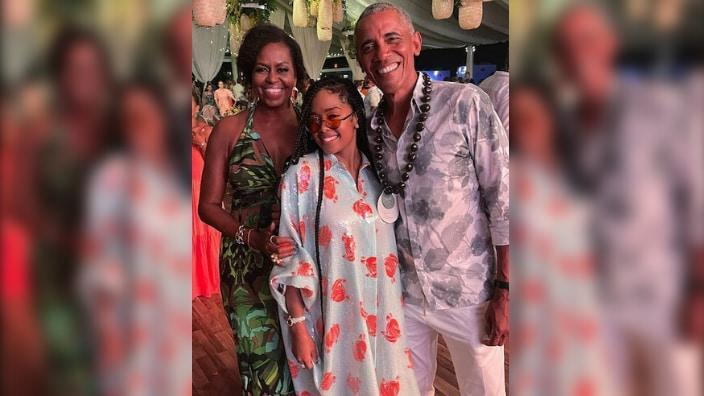 Former President and First Lady Barack and Michelle Obama pose with singer H.E.R. at his 60h birthday party in Martha's Vineyard