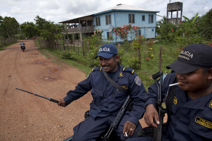 Honduran policemen patrol in Ahuas, Honduras, Monday, May 21, 2012. On Friday May 11, a joint Honduran-U.S. drug raid, on a helicopter mission with advisers from the DEA, appears to have mistakenly targeted civilians in the remote jungle area, killing four riverboat passengers and injuring four others. Later, according to villagers, Honduran police narcotics forces and men speaking English spent hours searching the small town of Ahuas for a suspected drug trafficker.(AP Photo/Rodrigo Abd)