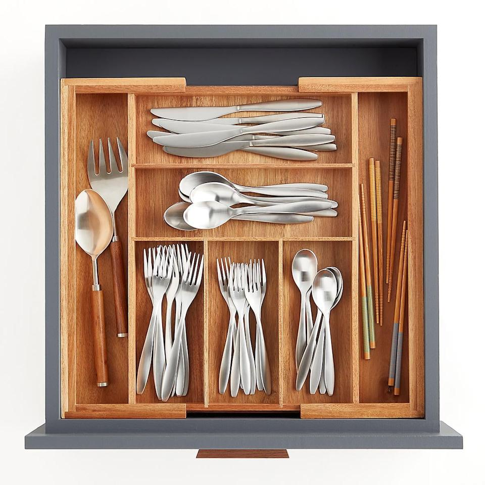 """<p>This <a href=""""https://www.popsugar.com/buy/Expandable-Acacia-Silverware-Tray-547065?p_name=Expandable%20Acacia%20Silverware%20Tray&retailer=containerstore.com&pid=547065&price=40&evar1=casa%3Auk&evar9=47184923&evar98=https%3A%2F%2Fwww.popsugar.com%2Fhome%2Fphoto-gallery%2F47184923%2Fimage%2F47185111%2FExpandable-Acacia-Silverware-Tray&list1=shopping%2Ccleaning%2Corganization%2Cspring%20cleaning%2Chome%20organization%2Chome%20shopping&prop13=api&pdata=1"""" rel=""""nofollow"""" data-shoppable-link=""""1"""" target=""""_blank"""" class=""""ga-track"""" data-ga-category=""""Related"""" data-ga-label=""""https://www.containerstore.com/s/whats-new/expandable-acacia-silverware-tray/1d?productId=11011628"""" data-ga-action=""""In-Line Links"""">Expandable Acacia Silverware Tray</a> ($40) will fit in all your drawers.</p>"""