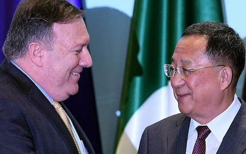 Mike Pompeo, US secretary of state, meets Ri Yong Ho, North Korea's foreign minister at a weekend summit in Singapore - Credit: Mohd Rasfan/AFP