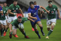 France's Francois Ceros centre, runs after the ball towards the line but his held back by Ireland's Caelan Doris, right, and a penalty try is awarded to France during the Six Nations rugby union international match between France and Ireland in Paris, France, Saturday, Oct. 31, 2020. (AP Photo/Thibault Camus)