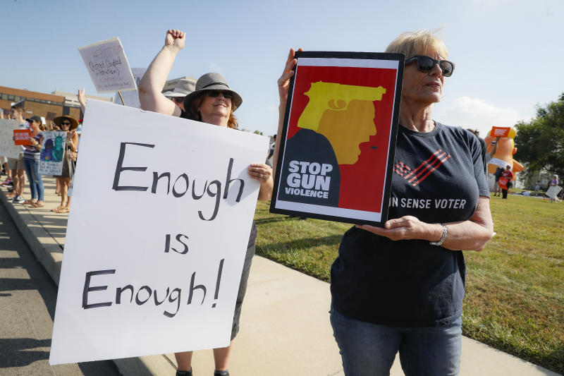 Demonstrators gather to protest the arrival of President Donald Trump outside Miami Valley Hospital, Aug. 7, 2019, in Dayton, Ohio. (Photo: John Minchillo/AP)