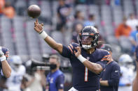Chicago Bears quarterback Justin Fields warms up before an NFL football game against the Detroit Lions Sunday, Oct. 3, 2021, in Chicago. (AP Photo/Nam Y. Huh)