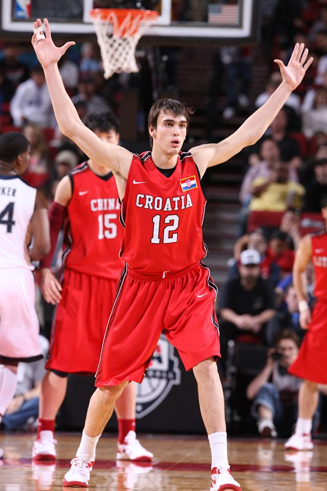 PORTLAND, OR - APRIL 7: Dario Saric #12 of the World Select Team defends against the USA Junior Select Team during the 2012 Hoop Summit on April 7, 2012 at the Rose Garden Arena in Portland, Oregon. NOTE TO USER: User expressly acknowledges and agrees that, by downloading and or using this photograph, User is consenting to the terms and conditions of the Getty Images License Agreement. Mandatory Copyright Notice: Copyright 2012 NBAE (Photo by Sam Forencich/NBAE via Getty Images)