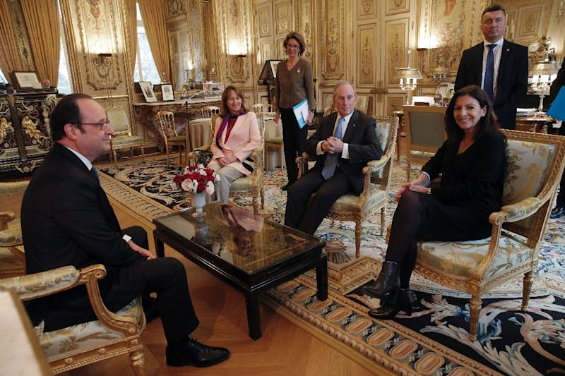French president Francois Hollande, French Minister for Ecology, Sustainable Development and Energy Segolene Royal, former New York City Mayor Michael Bloomberg and Paris mayor Anne Hidalgo during a meeting in Paris, on March 9, 2017