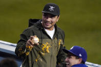 A fan turns around after being sprayed with nacho sauce when a ball hit for a solo home run by Los Angeles Dodgers' Justin Turner landed in his nachos during the third inning of a baseball game against the Colorado Rockies Wednesday, April 14, 2021, in Los Angeles. (AP Photo/Mark J. Terrill)
