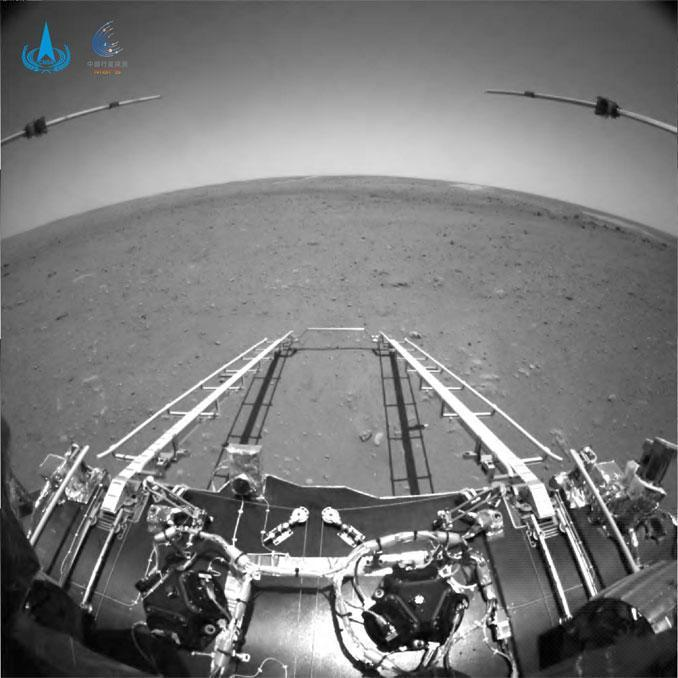 A shot taken by a hazard avoidance camera on China's Mars lander showing the ramps the rover will use to drive off onto the surface. / Credit: China National Space Administration