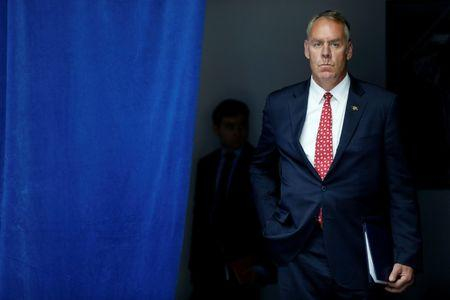 U.S. Interior Secretary Ryan Zinke waits to take the stage with President Donald Trump for his on infrastructure improvements, at the Department of Transportation in Washington, U.S. June 9, 2017.  REUTERS/Jonathan Ernst