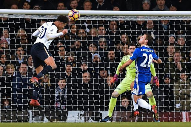 Tottenham Hotspur's midfielder Dele Alli (L) heads the opening goal past Chelsea's goalkeeper Thibaut Courtois (C) during the English Premier League football match in London, on January 4, 2017 (AFP Photo/IKIMAGES)