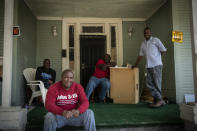"Pictured from left to right, Gregory Blanchard, 53, Clyde Lewis, 59, Tommy McCoy, 48 and Anthony Boggan, 49, pose for a group portrait on McCoy's front porch, in Meridian, Miss., on Tuesday, Oct. 6, 2020. Distrust of the government runs deep in the Black community in Mississippi, where harsh voter suppression tactics - voting fees, tests on the state constitution, even guessing the number of beans in a jar - kept all but about 6% of Black residents from voting into the 1960s. Boggan sometimes votes, but is sitting it out this year, disgusted at the choices. ""They're all going to tell you the same thing,"" he said. ""Anything to get elected."" (AP Photo/Wong Maye-E)"