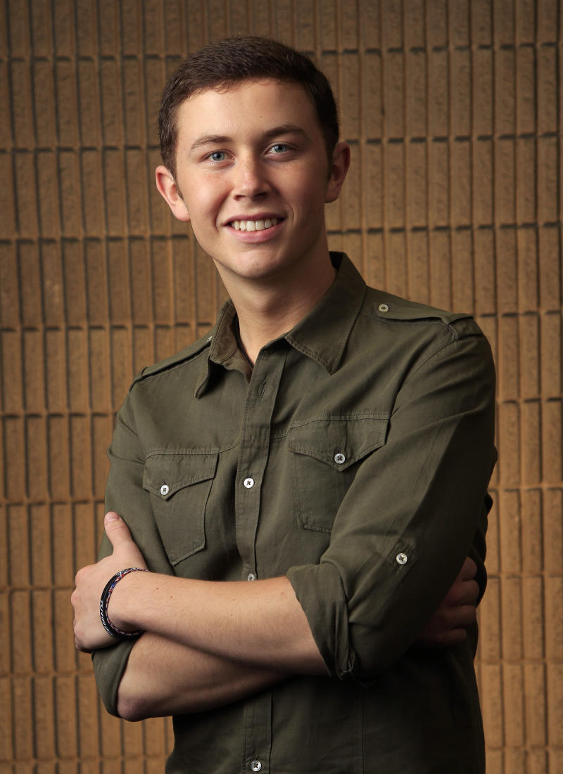 This March 8, 2012 photo shows Scotty McCreery in Nashville, Tenn. McCreery is one of several male performers included in the fan-voted top new artist category at the Academy of Country Music Awards. (AP Photo/Mark Humphrey)