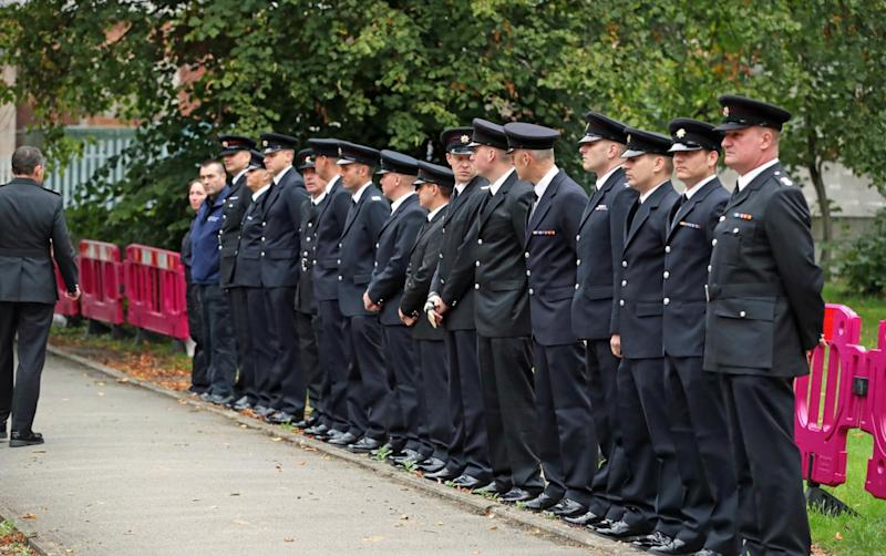 Emergency services personnel line up outside St Paul's Church in Walkden for the funeral (Peter Byrne/PA)