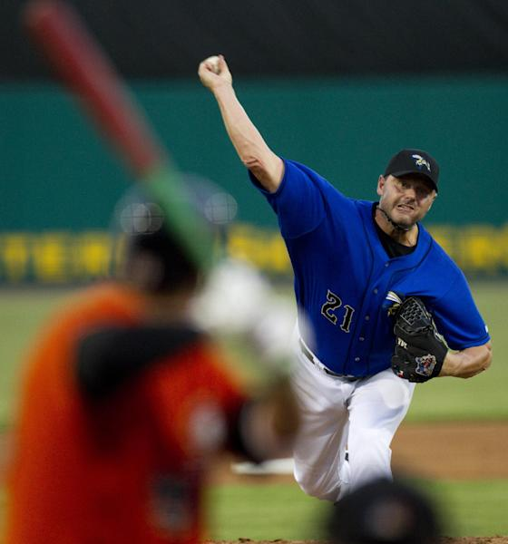 Sugar Land Skeeters starter Roger Clemens (21) releases a pitch to Long Island Ducks' Matt Esquivel during the second inning of a minor league baseball game at Constellation Field Friday, Sept. 7, 2012, in Sugar Land, Texas. (AP Photo/Houston Chronicle, Brett Coomer) MANDATORY CREDIT