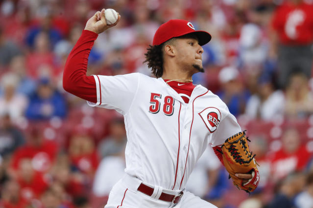 Cincinnati Reds starting pitcher Luis Castillo throws during the first inning of the team's baseball game against the Chicago Cubs, Friday, June 22, 2018, in Cincinnati. (AP Photo/John Minchillo)