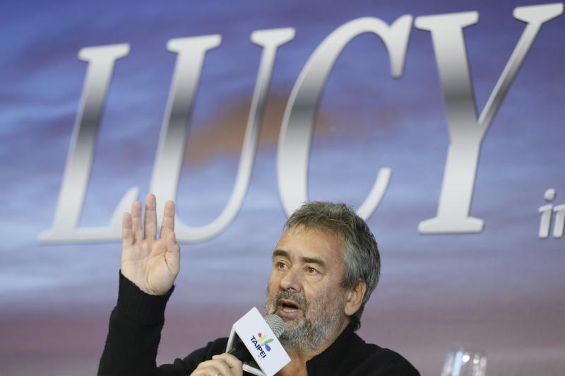 """Director Luc Besson talks to media after finishing parts of his filming in Taiwan for a new movie """"Lucy,"""" starring American actress Scarlett Johansson, in Taipei, Taiwan, Friday, Nov. 1, 2013. Besson slammed paparazzi in Taiwan for interfering with the shooting but denied reports that he considered leaving the island early to underscore his disgust over their actions. (AP Photo/Wally Santana)"""
