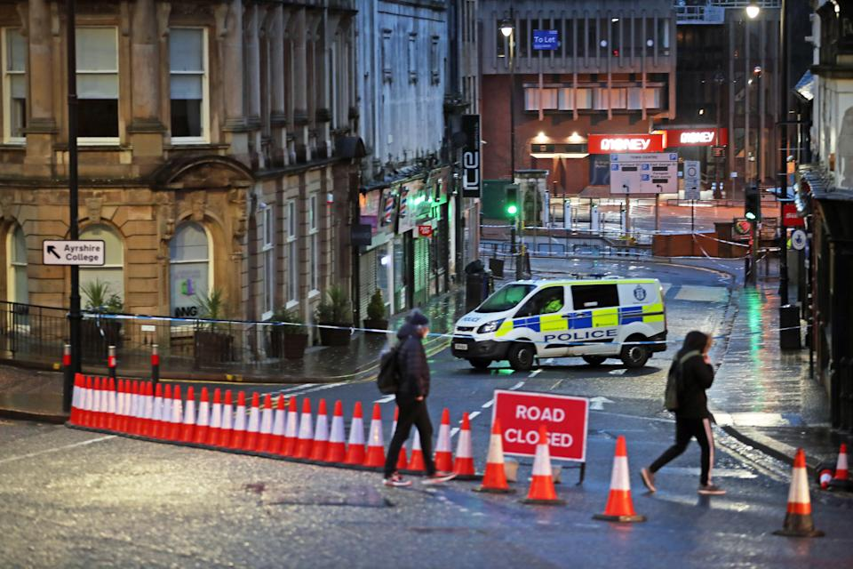 "A police cordon at West George Street in Kilmarnock, where officers continue to investigate what Police Scotland describe as a ""serious incident"" in the grounds of a local hospital and another location in the area. Picture date: Friday February 5, 2021."